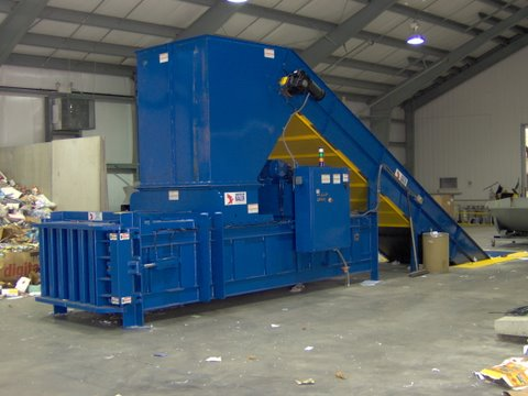 Shown is PW3560 manual tie baler with optional in-ground conveyor